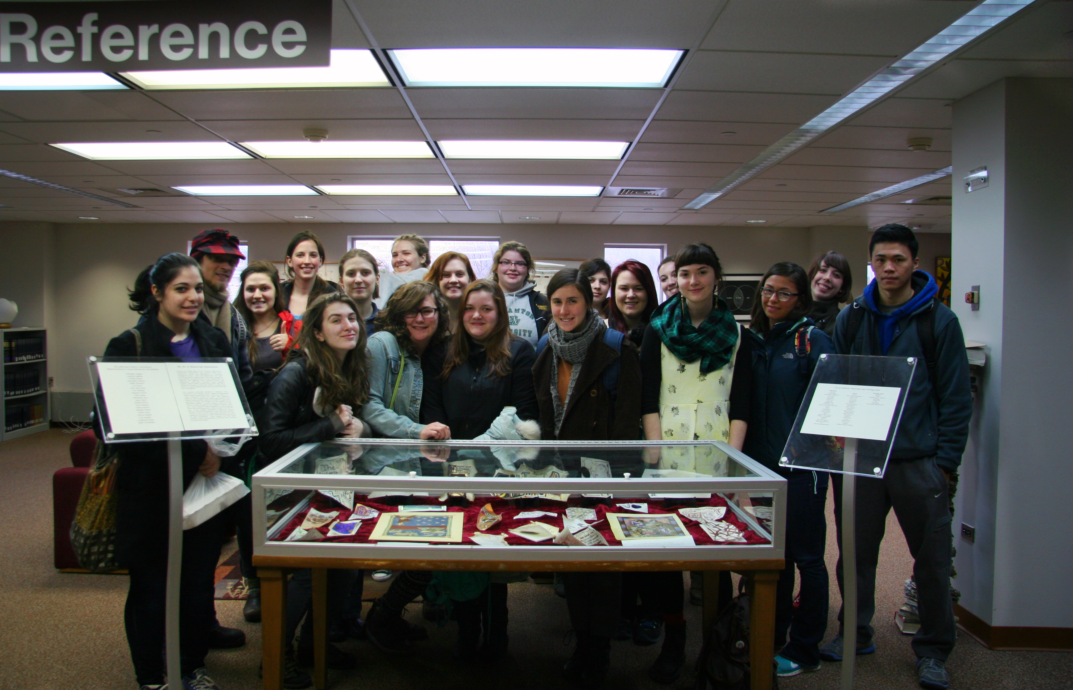 The full group with their works on display.