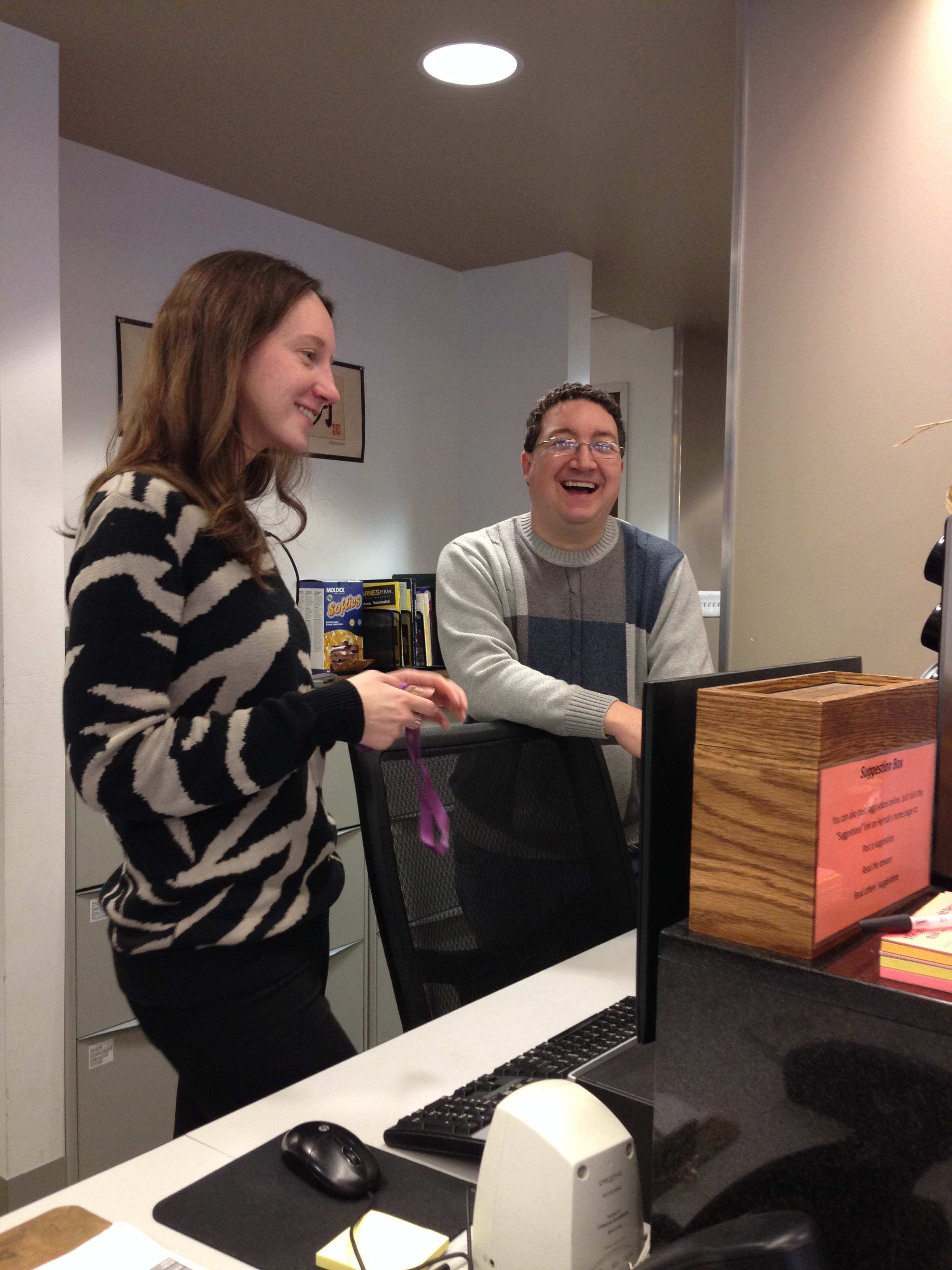 Brian and Natalie at Herrick's front desk
