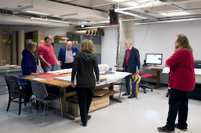 The group is looking at student prints that are going to Tsinghua University