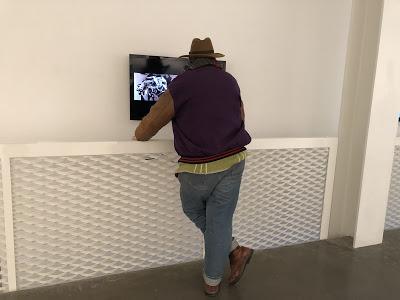 Prof. John Gill appreciating the video on flat screen
