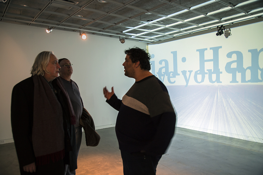 Omer (right) discussing his work with IEA Co-Directors Peer Bode and Joseph Scheer
