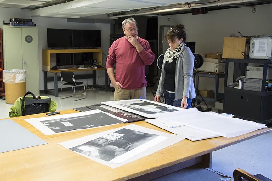 IEA Co-Director Joseph Scheer and IEA artist Cassandra Hooper viewing work from Cassandra's portfolio