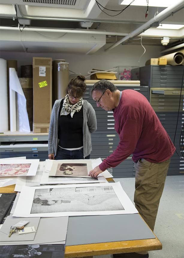 Joseph and Cassandra viewing work from Cassandra's portfolio