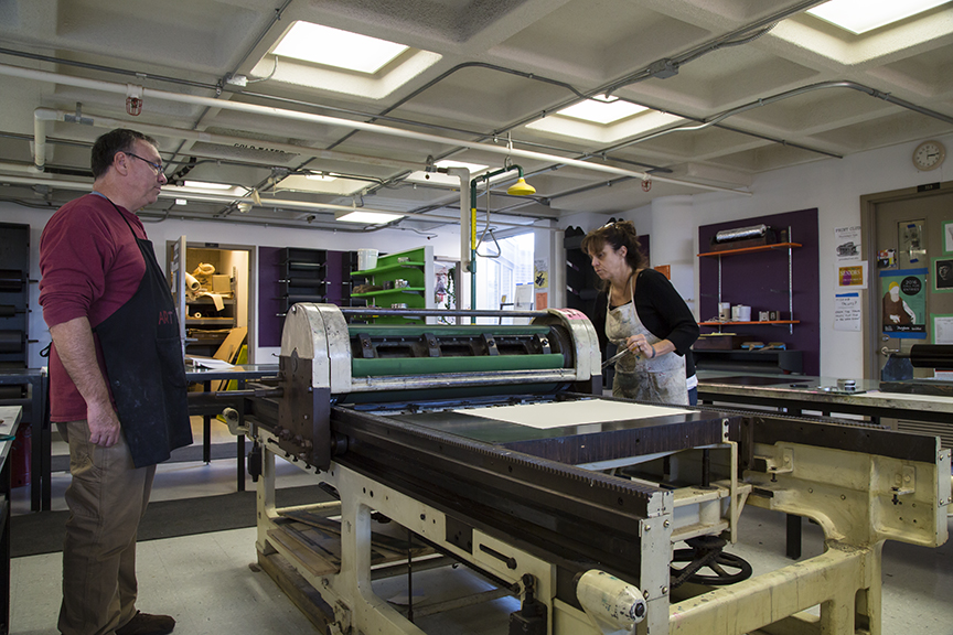 Cassandra and Joseph printing with the offset press