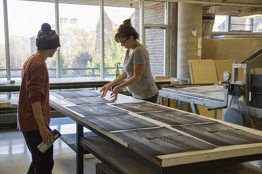 Cassandra laying out polymer plate prints with Aodi Liang