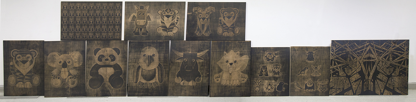 Michael and Jenny's collection of laser etched wood blocks they produced and printed