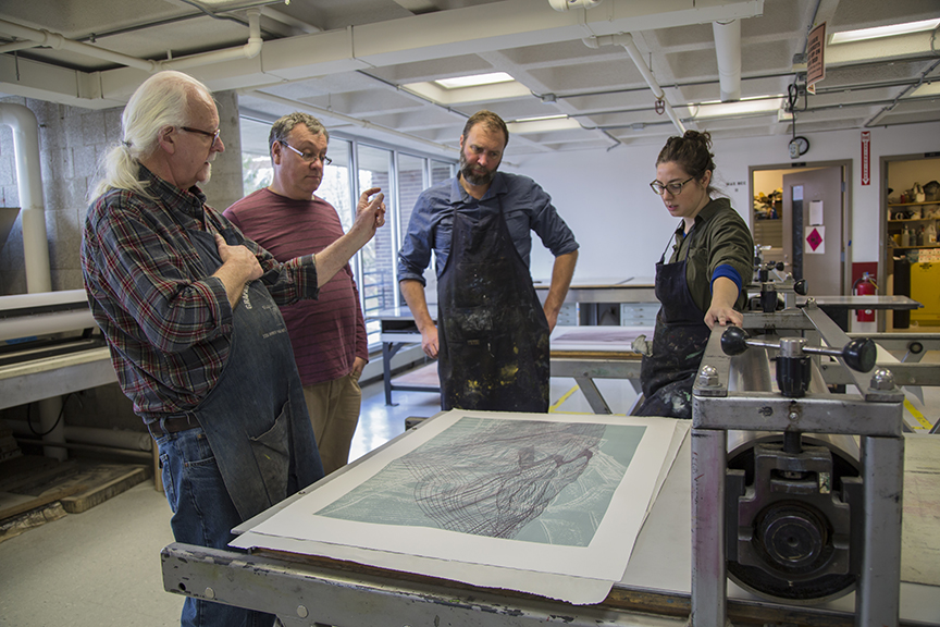 Discussing print with IEA co-director Joseph Scheer (second from left)