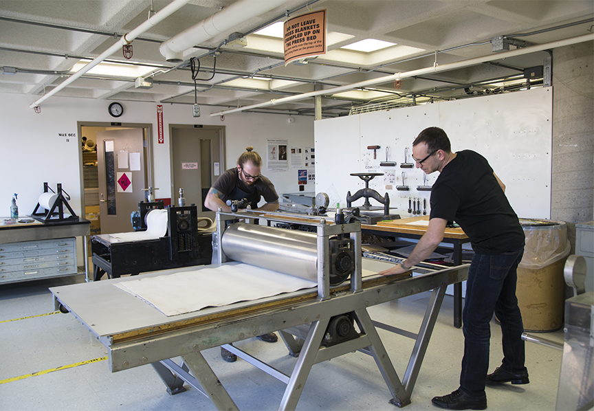 Chad (right) and IEA technician and master print maker Tim Pauszek pressing a polymer plate print