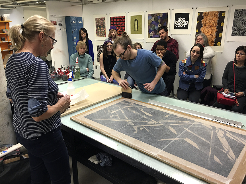 A larger scale demonstration of collé printing on Japanese and Chinese papers. NYSCC print technician Tim Pauszek assists Jenny with her demonstration