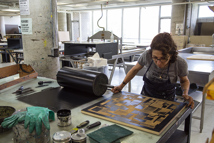 Catherine preparing a photo polymer plate for printing