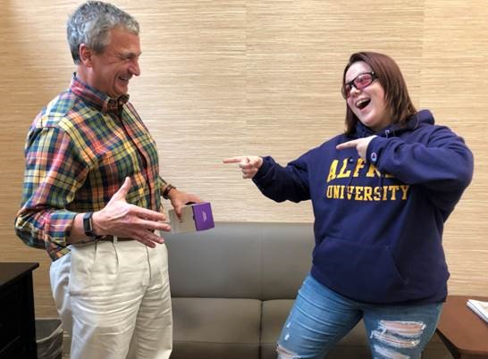 Current AU student Alisha Horne '22 looks at President Zupan's shirt with her new Enchroma glasses