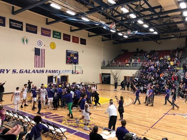 Fans storm the court after men's basketball victory