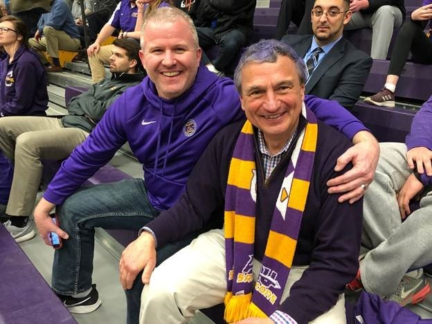VP Jason Amore and President Zupan show off their purple & gold