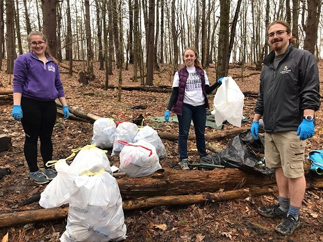 From left: Natalie Poklop '21, Ashlee Wilmier '19, and Seth Steele '19 clean up a portion of the Pine Hill Trails.