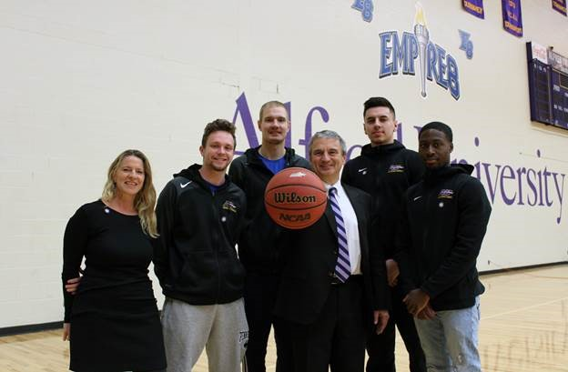 Leaders for the future: Alfred University Men's Basketball team members, from left, Scotty Stopera '19, Sage Brown '19, Dom LeMorta '19, and Pat McLamore '19 with Kathy Woughter '93 MS, vice president for Student Affairs, and president Mark Zupan.